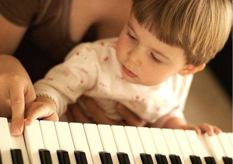 children learning to play the piano